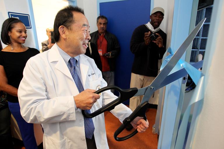 Dr. Dan Tanita cuts a ribbon at Peres Elementary Dental Clinic