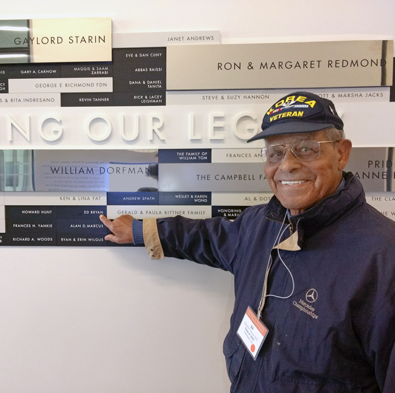 Dr. Edward Bryan in front of Donor Wall at the Dugoni School